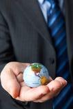 Zakenman Holding Globe Showing Noord-Amerika ter beschikking stock fotografie