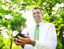 Zakenman Holding Tree Plant Forest Concept Stock Foto
