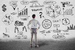 Zakenman in kostuum en businessplan Stock Afbeelding