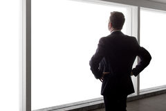 Zakenman Looking Out een Groot Venster royalty-vrije stock foto