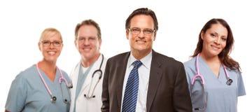 Zakenman met Artsen en Verpleegsters Stock Afbeeldingen