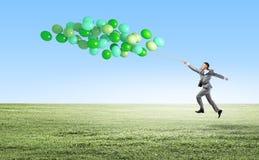 Zakenman met ballons Stock Afbeelding