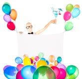 Zakenman met banner, ballons en cocktail Royalty-vrije Stock Foto