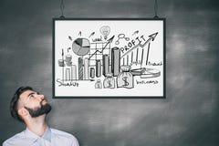 Zakenman met bedrijfskrabbel in kader Stock Afbeelding