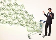 Zakenman met boodschappenwagentje met dollarrekeningen Stock Afbeeldingen