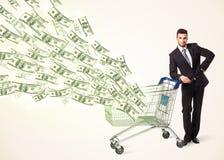 Zakenman met boodschappenwagentje met dollarrekeningen Royalty-vrije Stock Afbeeldingen