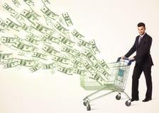 Zakenman met boodschappenwagentje met dollarrekeningen Royalty-vrije Stock Afbeelding