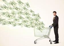 Zakenman met boodschappenwagentje met dollarrekeningen Royalty-vrije Stock Foto