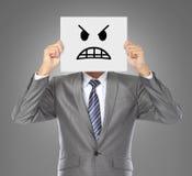 Zakenman met boos masker Stock Foto