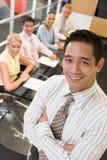 Zakenman met businesspeople vier Stock Afbeelding