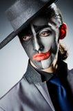 Zakenman met clownverf Stock Foto