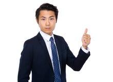 Zakenman met duim op gebaar Stock Foto