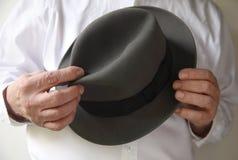 Zakenman met een oude vilten hoed Stock Afbeelding