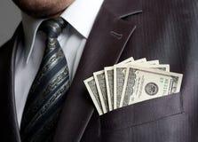 Zakenman met geld in kostuumzak Stock Foto's