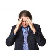 Zakenman met grote hoofdpijn stock foto's