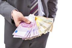 Zakenman met in hand geld Royalty-vrije Stock Afbeelding
