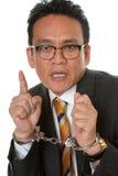 Zakenman met handcuffs Stock Foto's