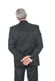 Zakenman met handen achter rug Stock Foto