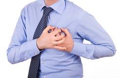 Zakenman met hartaanval. Stock Foto