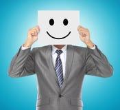 Zakenman met het glimlachen masker Stock Fotografie