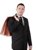 Zakenman met het winkelen zak Stock Afbeelding