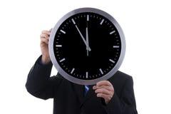 Zakenman met klok Stock Fotografie