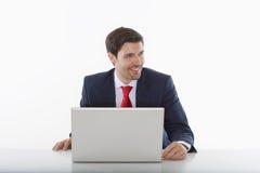 Zakenman met laptop Royalty-vrije Stock Afbeeldingen