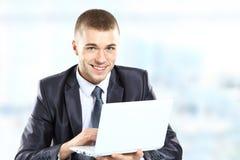 Zakenman met laptop royalty-vrije stock afbeelding