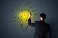 Zakenman met lightbulb Stock Foto