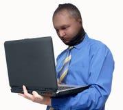 Zakenman met masker en laptop Stock Fotografie