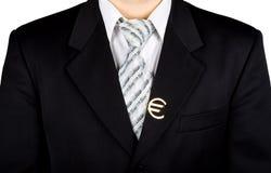 Zakenman met metaal euro teken op zijn kostuum Royalty-vrije Stock Afbeeldingen