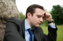 Zakenman met migraine Stock Afbeelding