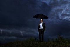 Zakenman met onweersbui Stock Foto