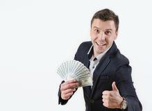Zakenman met pakje van geld in studio op een witte achtergrond Royalty-vrije Stock Afbeelding