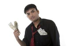 Zakenman met pakjes van geld Stock Foto's