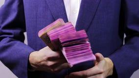 Zakenman met Pakjes van Geld in Handen stock footage