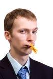 Zakenman met wasknijper op zijn mond Stock Foto