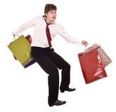 Zakenman met zak het winkelen. Stock Fotografie