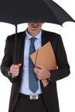 Zakenman onder een paraplu Stock Foto