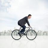 Zakenman op een fiets Royalty-vrije Stock Afbeeldingen