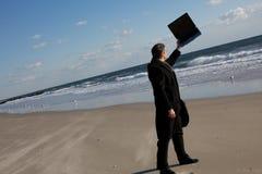 Zakenman op het strand stock foto's