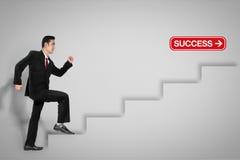 Zakenman op ladder aan succes stock foto