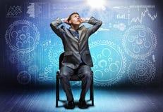 Zakenman op stoel Stock Foto
