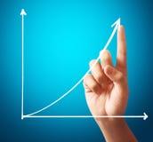 Zakenman Touching een Grafiek Stock Afbeeldingen