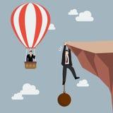 Zakenman in van de de vliegpas van de hete luchtballon de zakenmangreep op Stock Fotografie