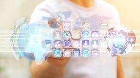 Zakenman verbindende werelden aan pictogrammen en toepassingensoftware Royalty-vrije Stock Afbeeldingen