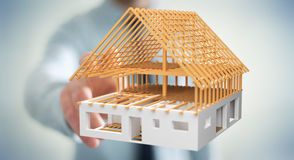 Zakenman wat betreft 3D het teruggeven onvolledig planhuis met van hem Stock Fotografie