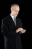 Zakenman Writing Sms op Telefoon stock foto's