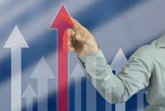 zakenmanhand die aan bovenkant van Rode pijl in uw het werkconce richten stock afbeelding