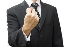 Zakenmanhand die een fig.teken tonen stock afbeelding